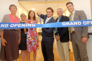 Photo of hospital trustees, officials and local dignitaries cutting the ribbon to new surgical center at Copley Hospital.
